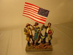 Brandweermannen met vlag